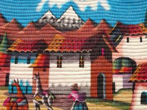 banos ecuador city view in a wool handicraft